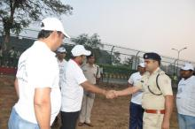 Shaking Hand Member and Police Officer